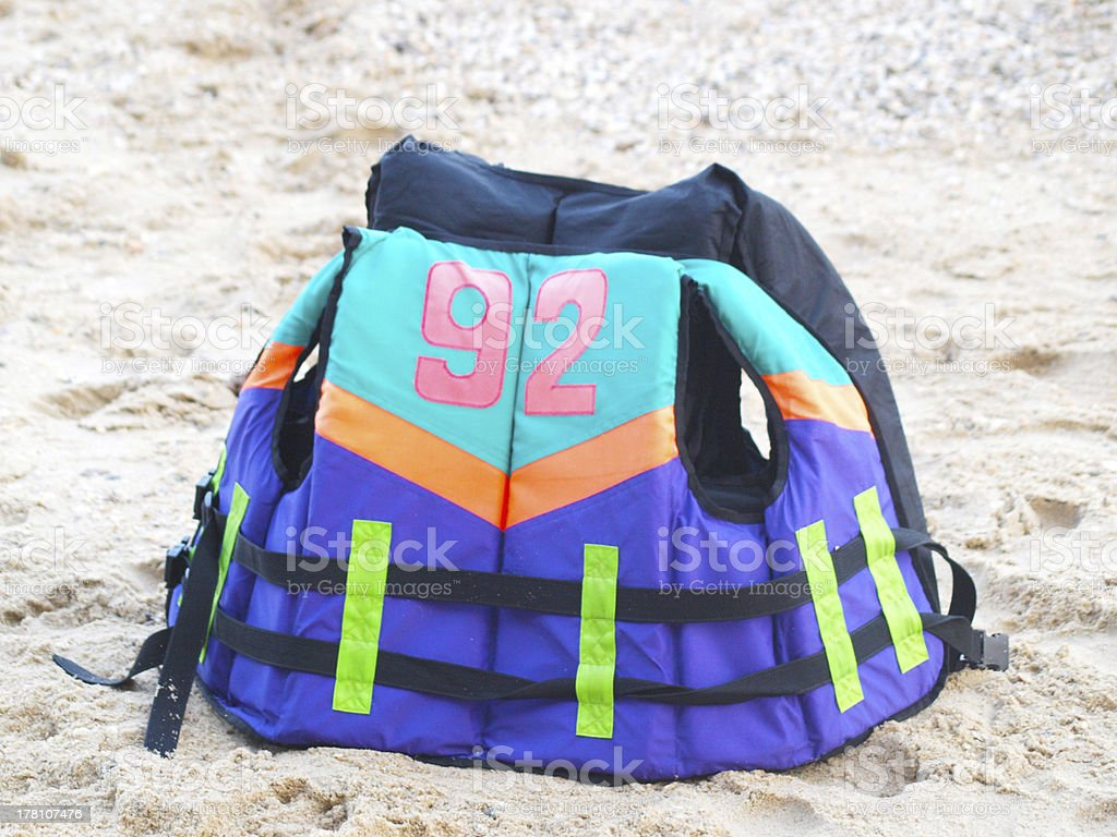Life jacket on a sandy beach royalty-free stock photo
