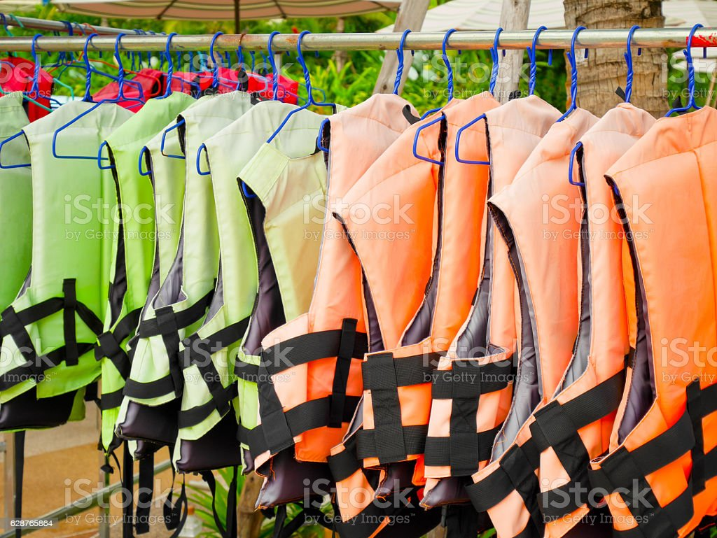 Life jackets hanging on a rack stock photo