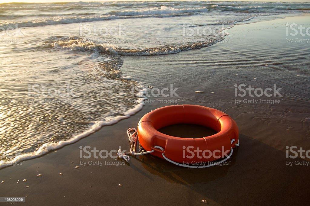 Life preserver alone on Mediterranean Sea stock photo