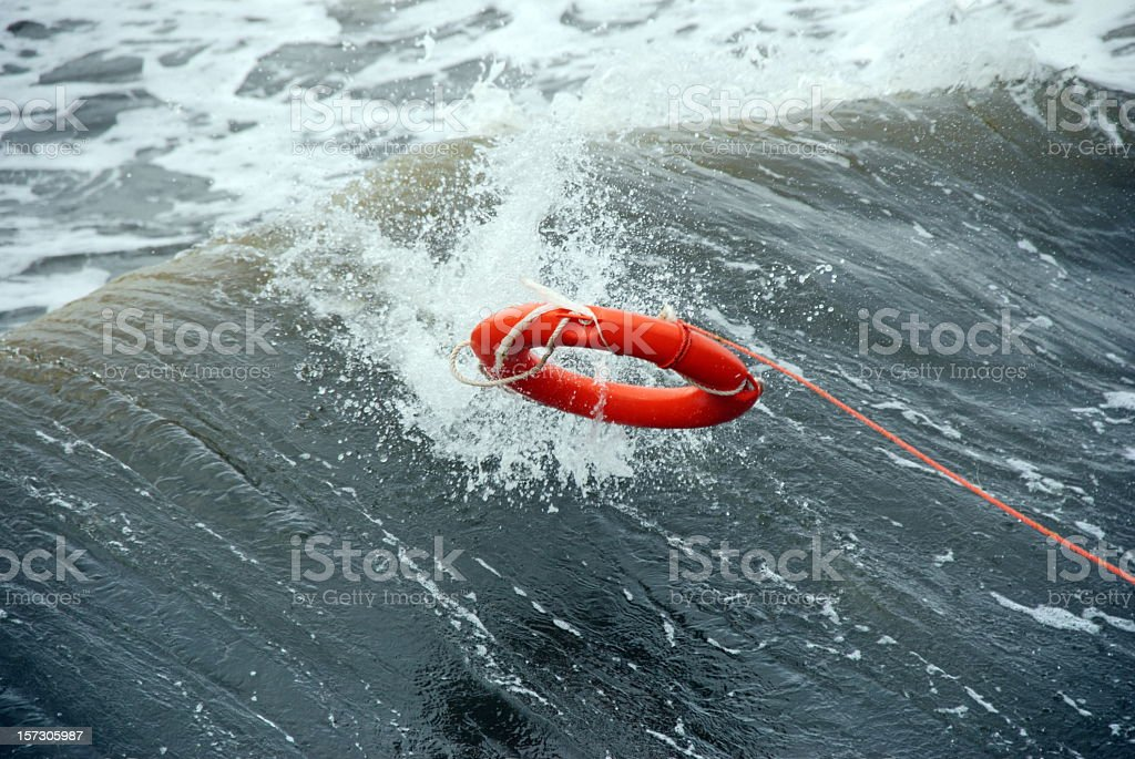 A life preserver being thrown into the water stock photo