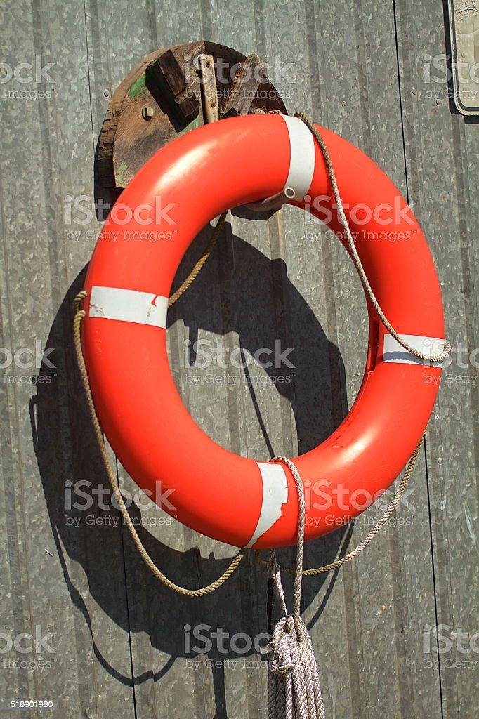 Life preserver hanging on wall stock photo