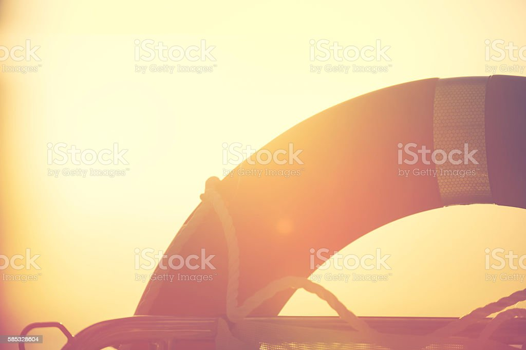 Life preserver in the sunset. stock photo