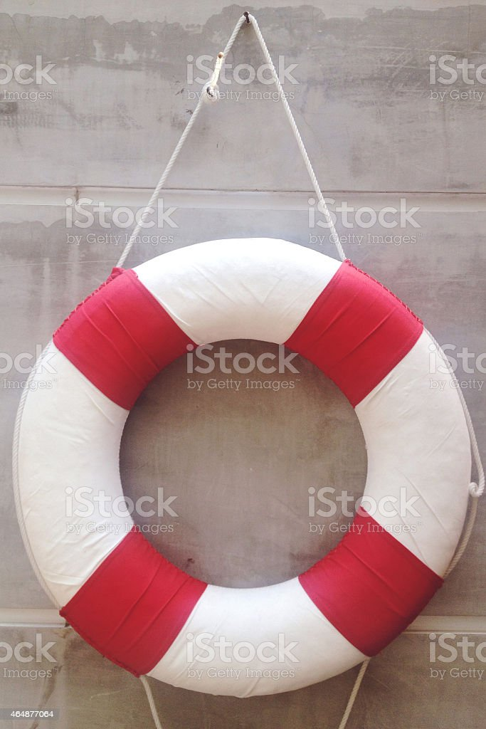 Life preserver on a wall stock photo
