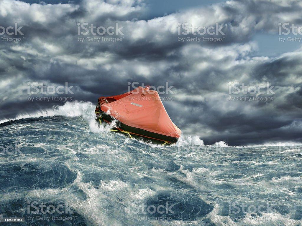 Life raft in stormy ocean stock photo