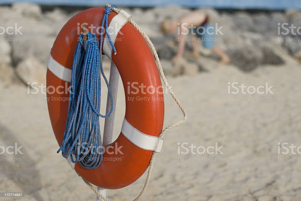 Life ring and child on a beach royalty-free stock photo
