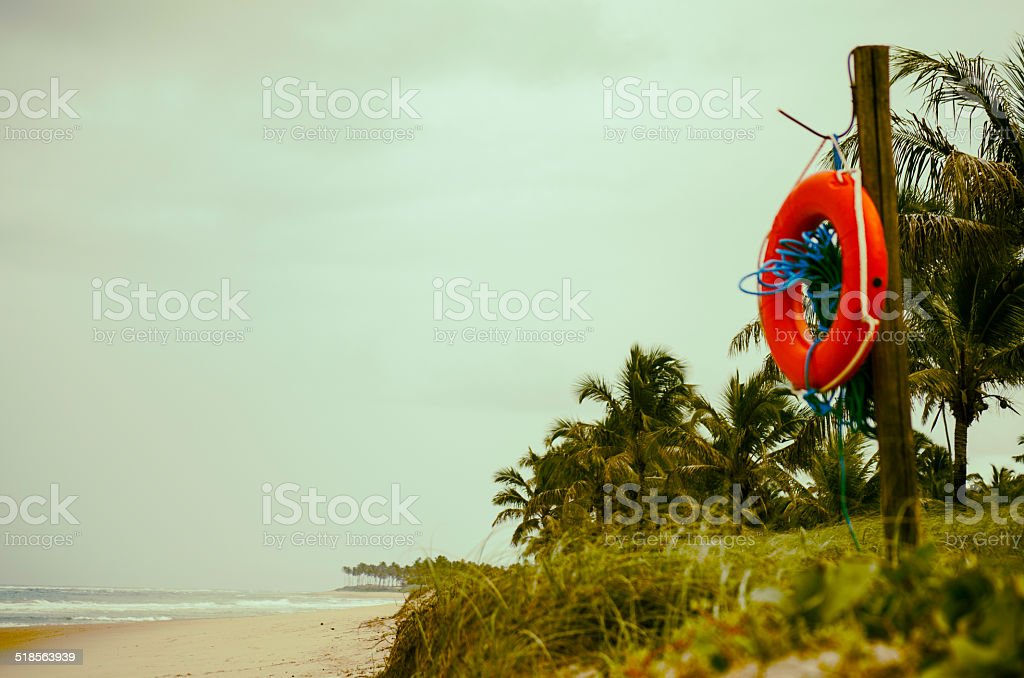 life ring at tropic beach stock photo