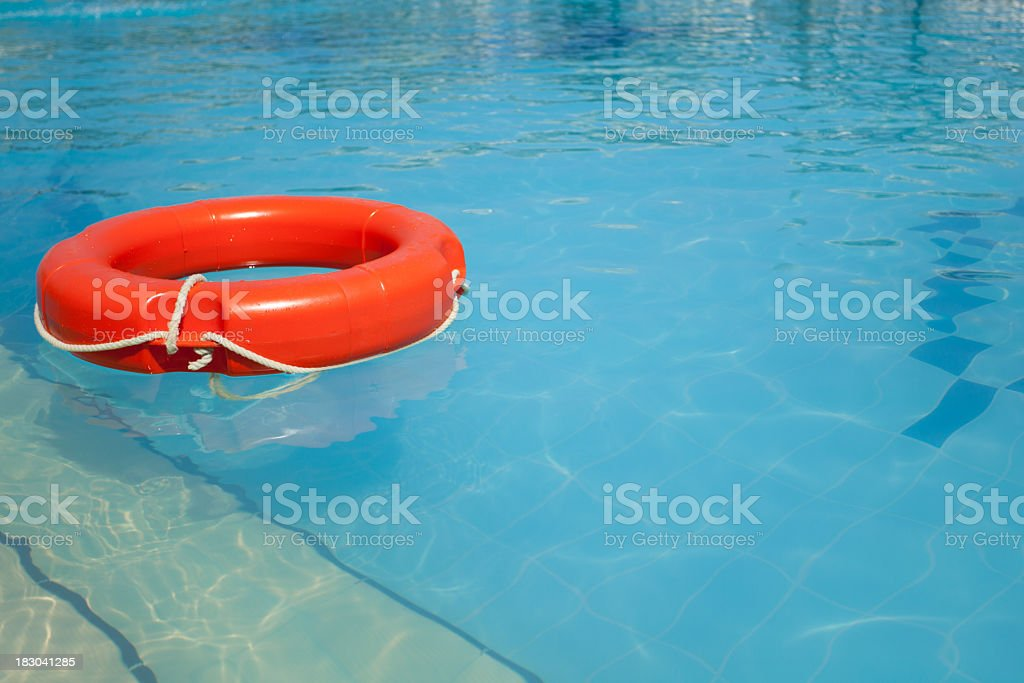 Life ring floating in pool royalty-free stock photo