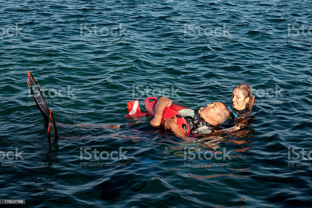 Life Saver is Rescue the tired adult man royalty-free stock photo