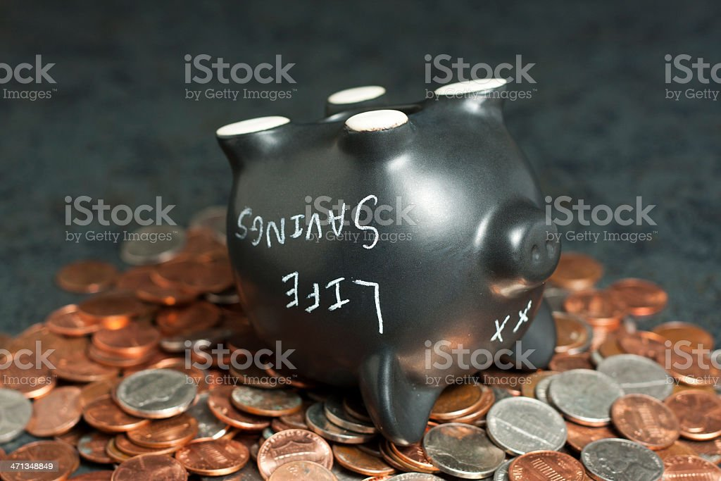 Life Savings Piggy Bank Tits-Up on Coins stock photo