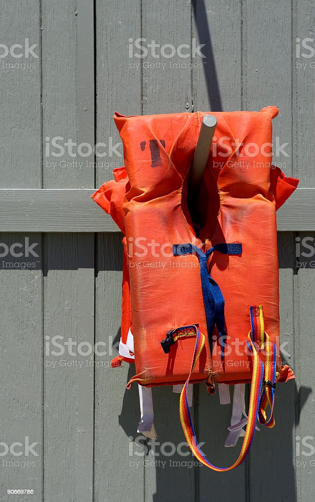 Life vest on wooden pole royalty-free stock photo