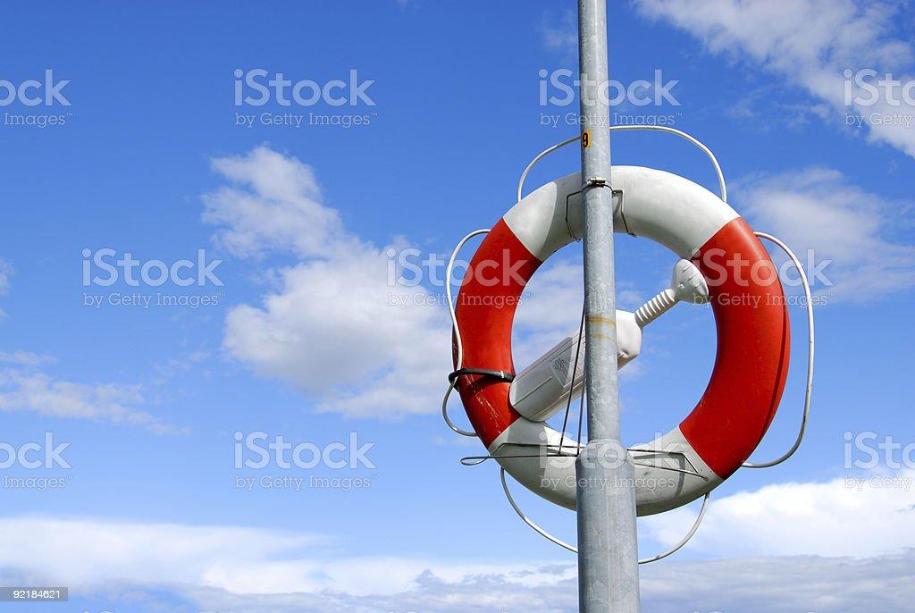Life-belt against blue sky 1 royalty-free stock photo