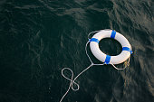 Lifebelt, lifebuoy in a dangerous sea for help, safety,security