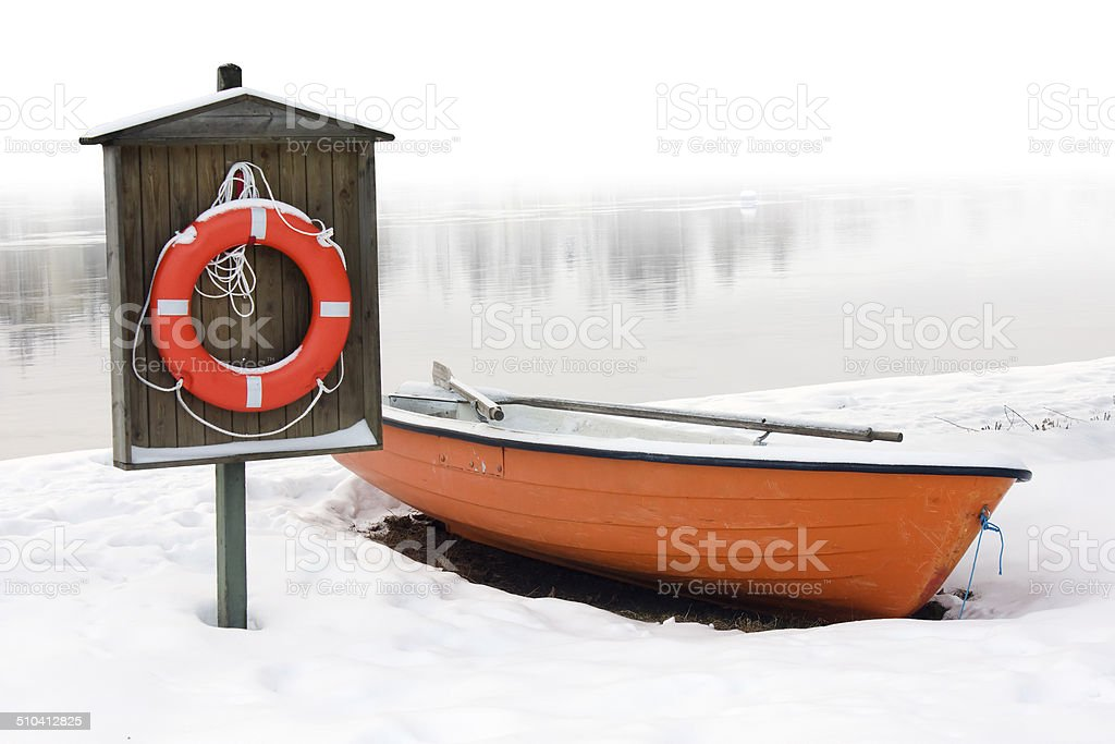 Lifeboat and lifebuoy on the snow stock photo
