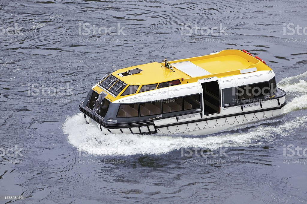 Lifeboat floats on sea royalty-free stock photo