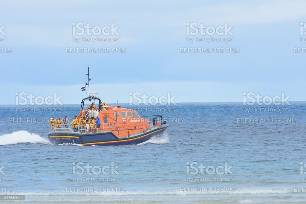RNLI lifeboat heading out to sea on training mission stock photo