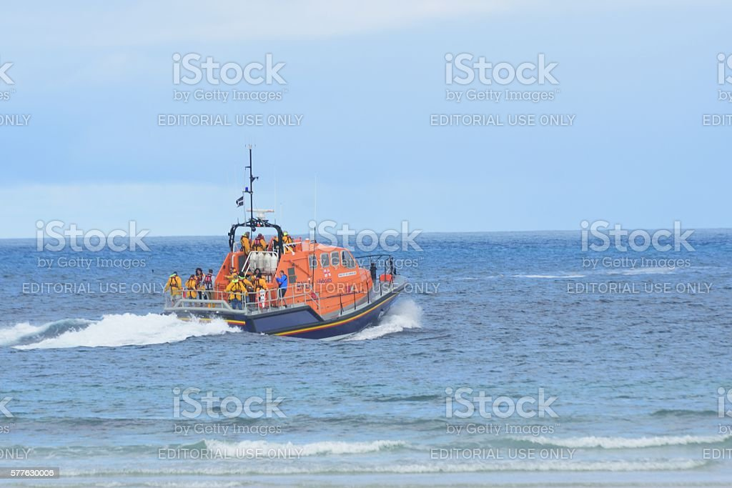 RNLI lifeboat heading out to sea stock photo