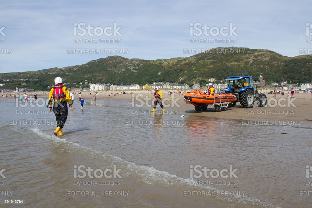 Lifeboat launched on Barmouth beach stock photo
