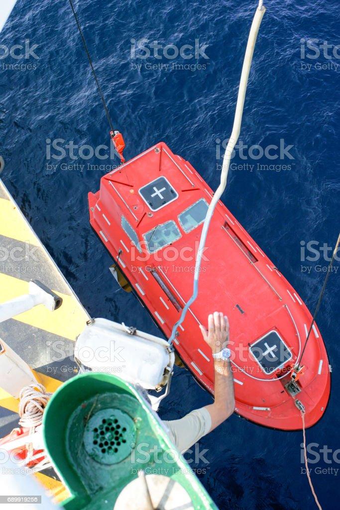 lifeboat of roro vessel stock photo