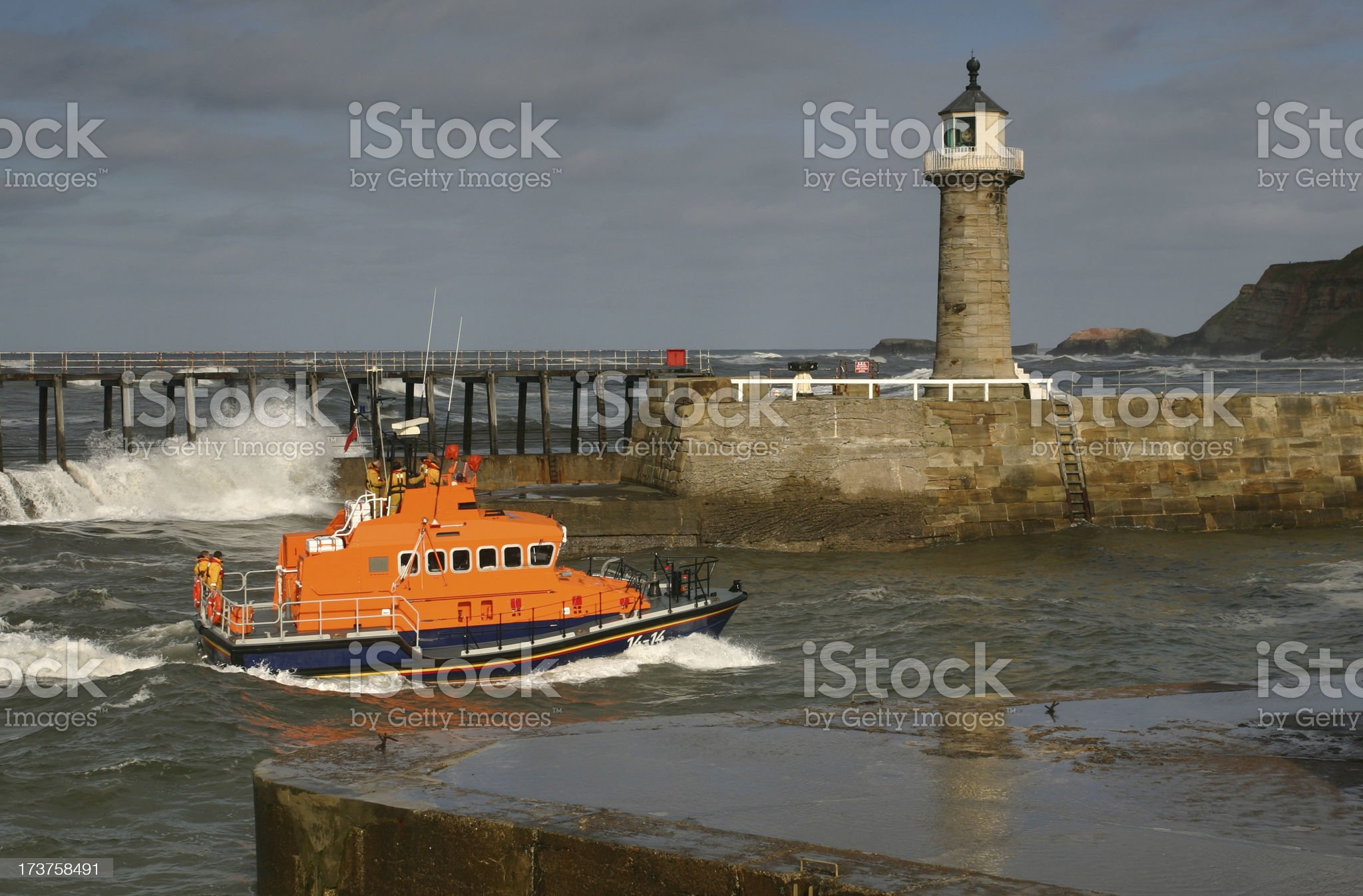 lifeboat returns safely to harbour royalty-free stock photo