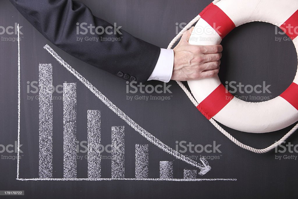 Lifebuoy and Businessman stock photo