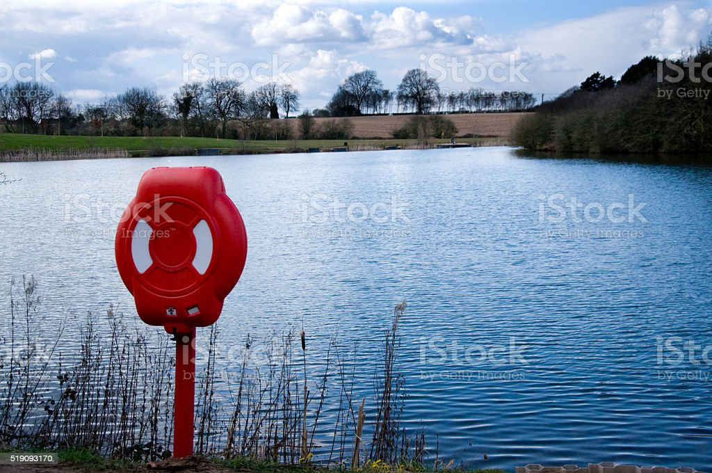Lifebuoy By Lake stock photo