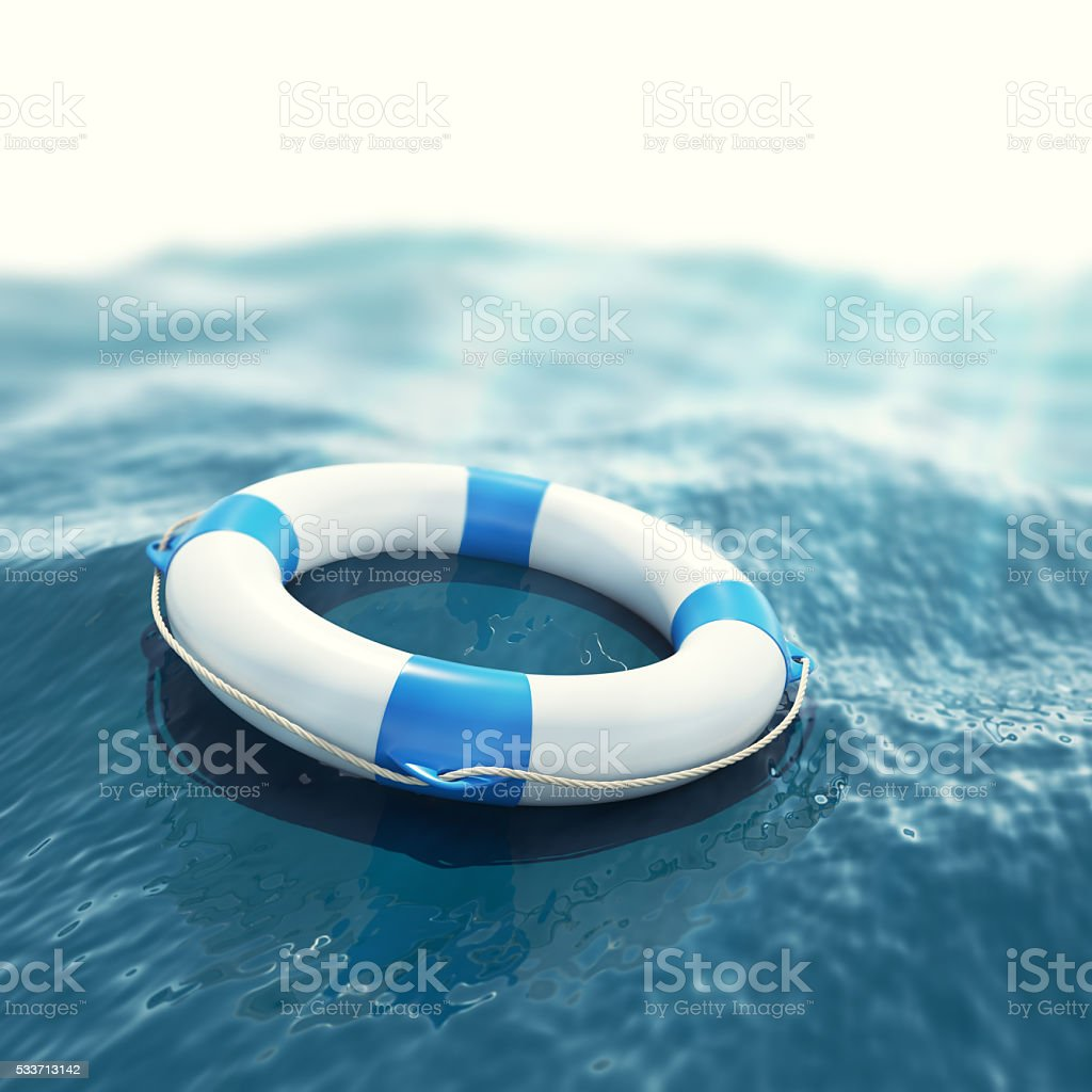 Lifebuoy floating in a stormy sea with the effect of stock photo