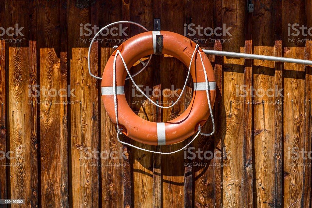 Lifebuoy hanging on a beach stock photo