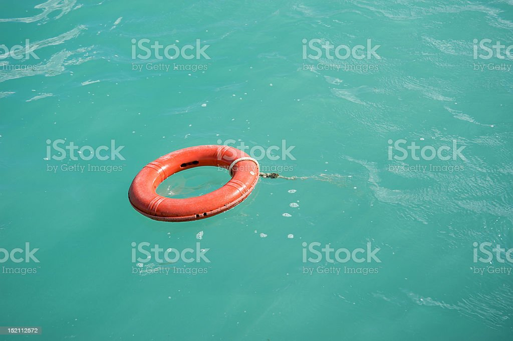 Lifebuoy in the ocean royalty-free stock photo
