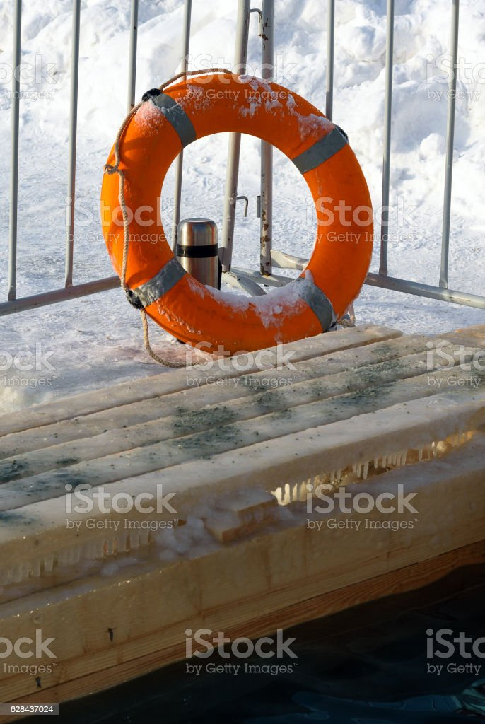 Lifebuoy near Ice-hole on Epiphany day. Russia stock photo