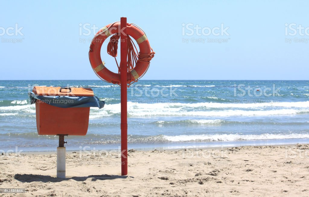 lifebuoy on the beach stock photo