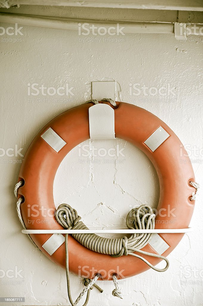 Lifebuoy on the wall royalty-free stock photo