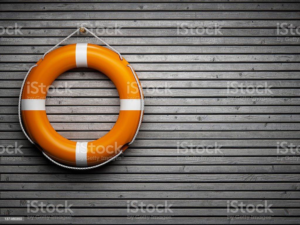 Lifebuoy on wooden wall stock photo