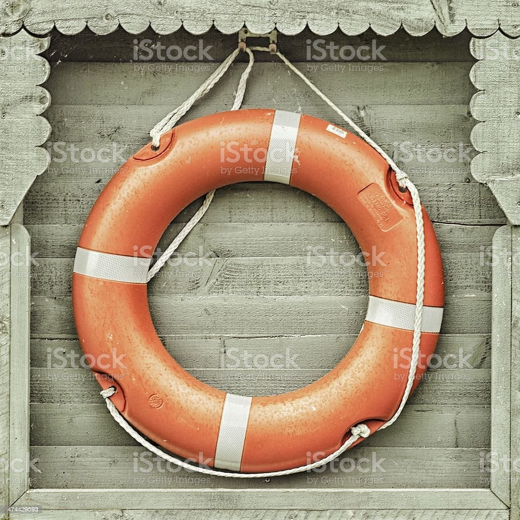 Lifebuoy, ring buoy, lifering, lifesaver in wooden housing stock photo