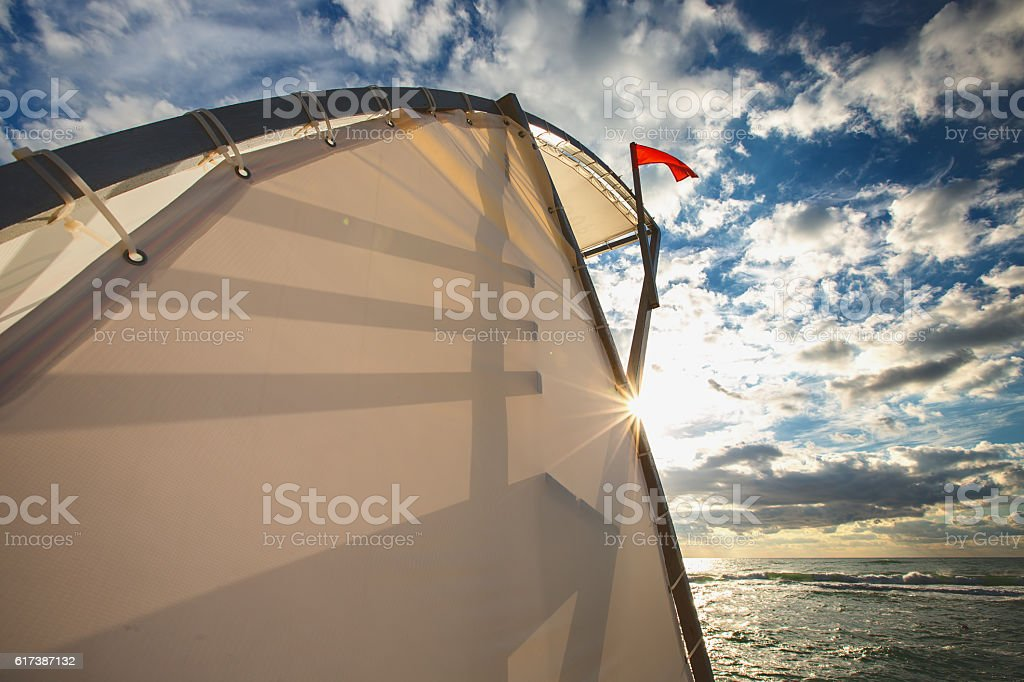 Lifegard stand, Red flag and sea stock photo