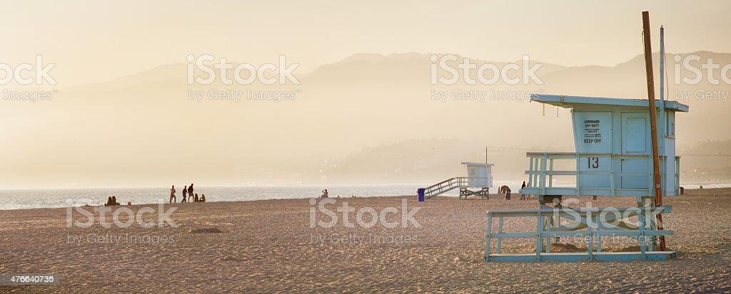Lifeguard cabin at sunset on Santa Monica beach panorama stock photo