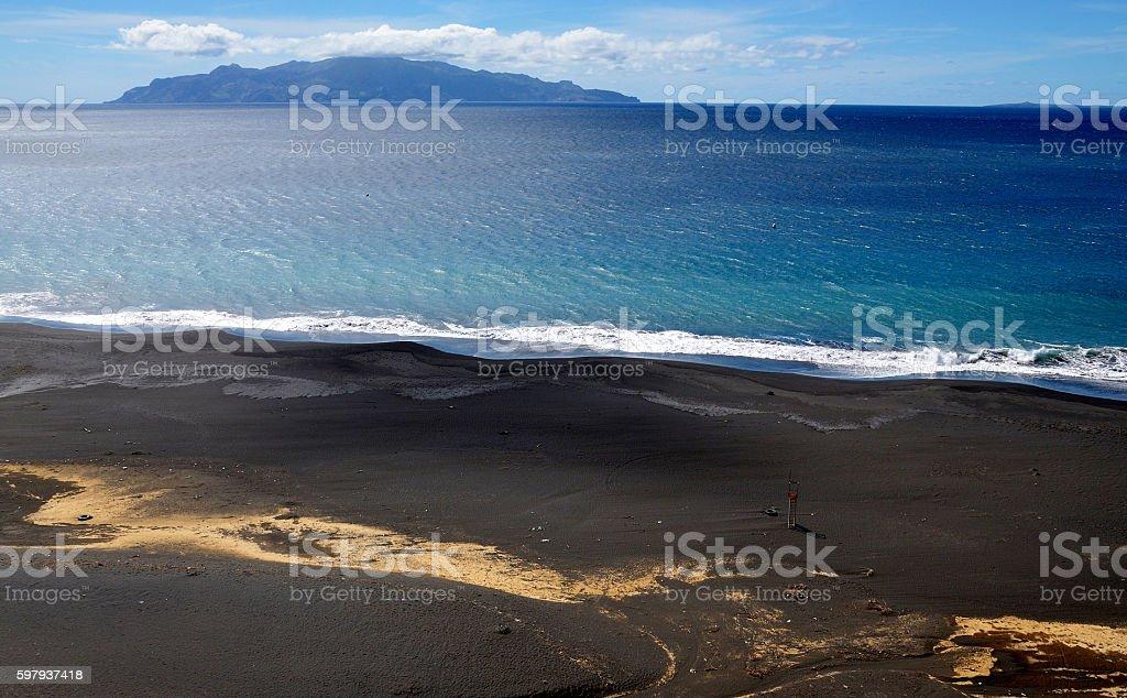 Lifeguard chair on an empty black sand beach stock photo