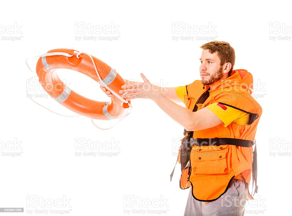 Lifeguard in life vest with ring buoy lifebuoy. stock photo