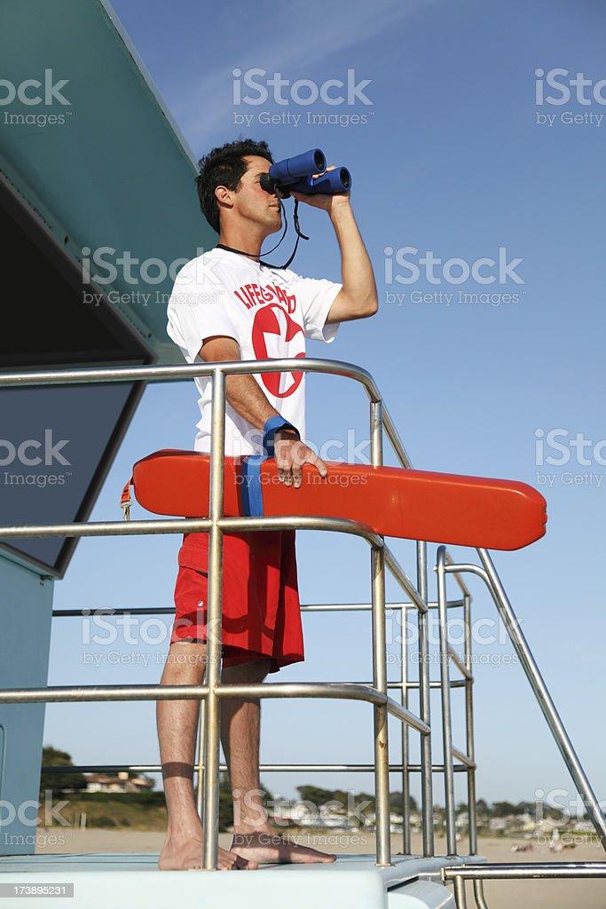 Lifeguard Looking Through Binoculars stock photo