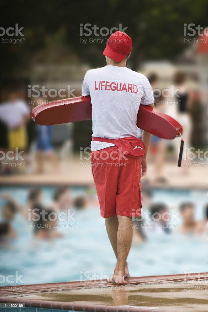 Lifeguard on duty in swimming pool stock photo