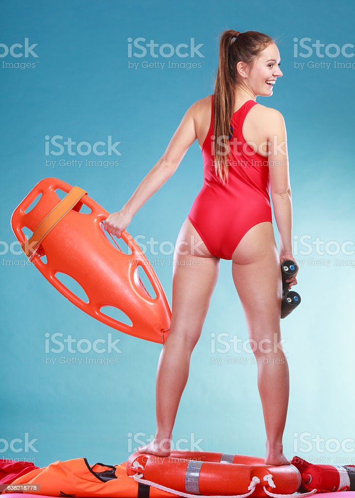 Lifeguard on duty with rescue buoy supervising. stock photo