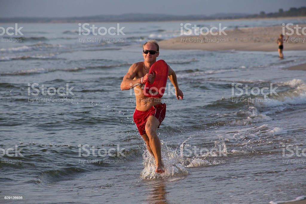 lifeguard on the beach with glasses, with a life buoy stock photo