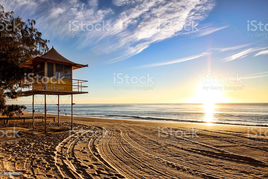 Lifeguard patrol tower on the beach at sunrise, Gold Coast stock photo