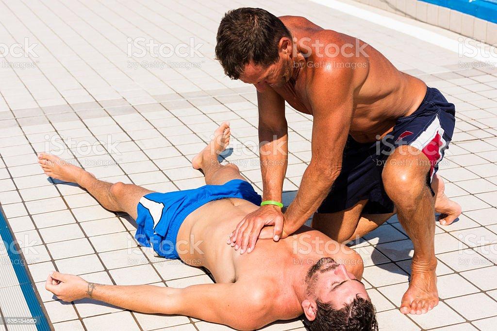 Lifeguard Performing Cardiopulmonary Resusctation (CPR) stock photo