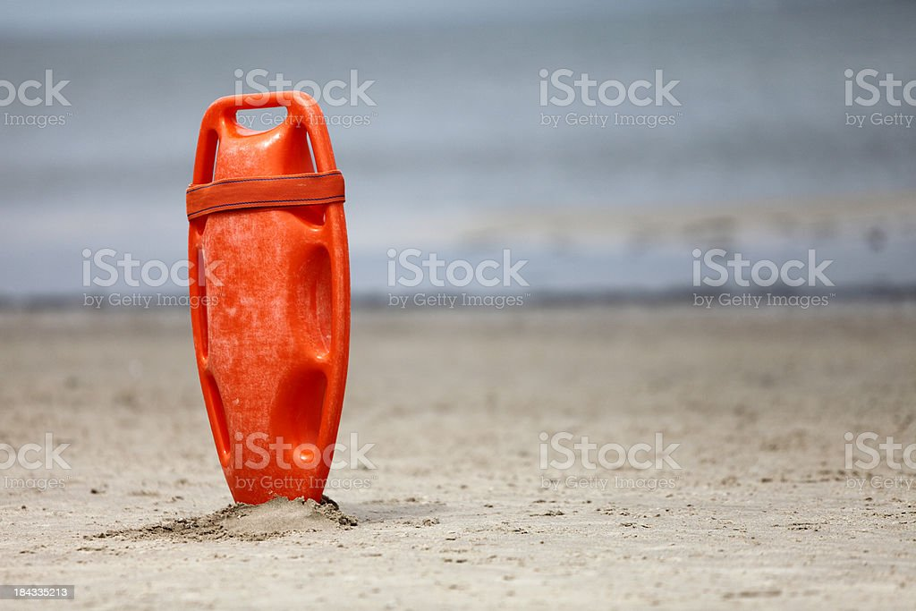 Lifeguard Rescue Can Amid Sand XXXL royalty-free stock photo