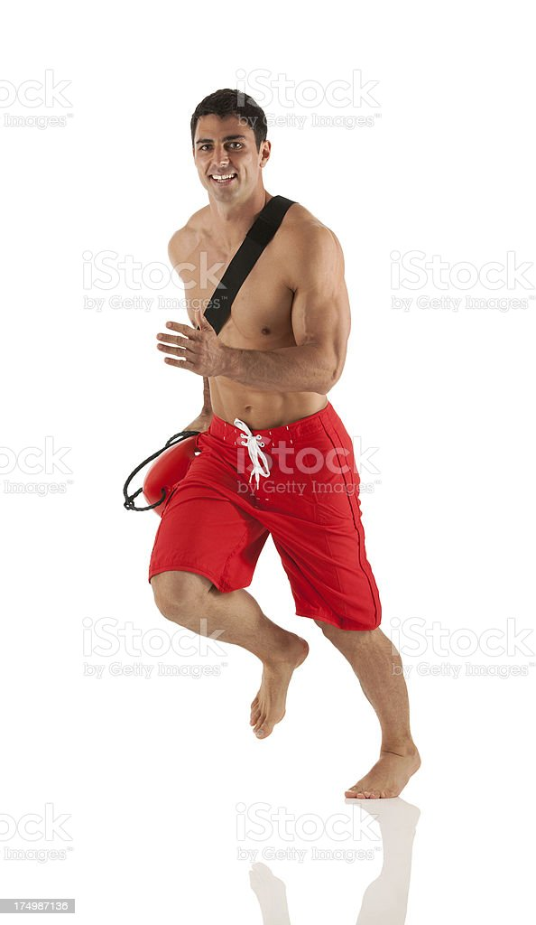 Lifeguard running with a float royalty-free stock photo