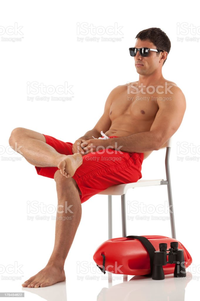Lifeguard sitting on chair royalty-free stock photo