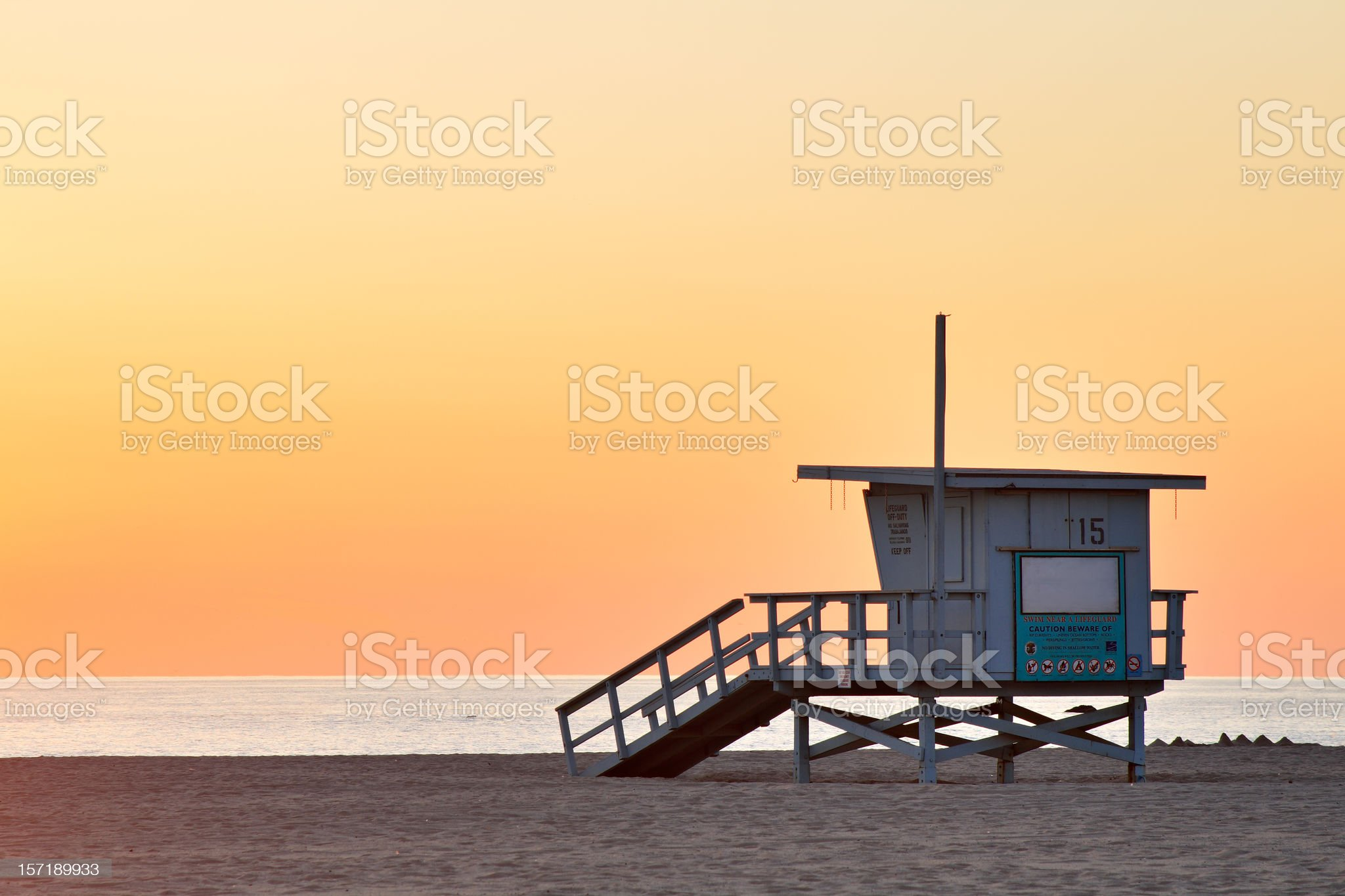 Lifeguard station at the empty beach during sunset royalty-free stock photo