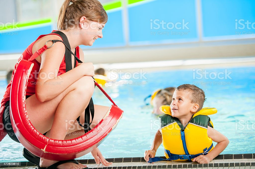 Lifeguard Talking to Child stock photo