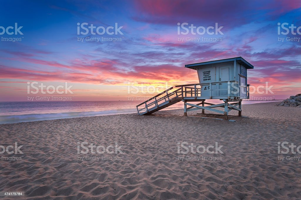 Lifeguard tower on the Beach at Sunset stock photo