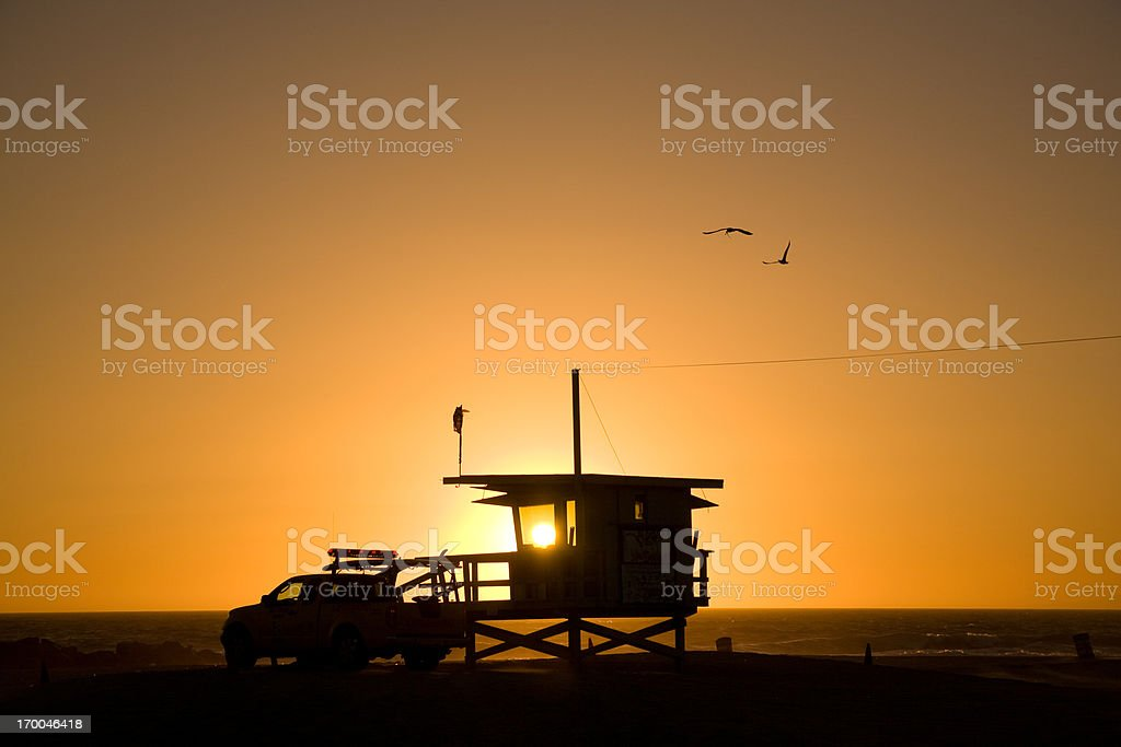 Lifeguard Tower & Pickup at Sunset, with birds royalty-free stock photo